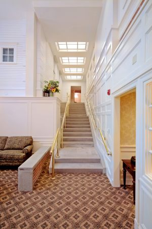 Stairway Bridging New Facility with Historic Mansion